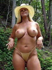 Sexy and Busty BBW in a big yellow hat posing naked, see more nude women now!