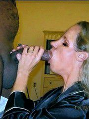 A man with a big ebony dick and huge balls fucks mature Blonde in the mouth
