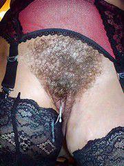 Cum flows through hairy pussy