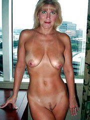 Sport old woman with muscular body posing nude