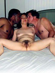 Naked milf with shaggy pussy, it lies between two lovers