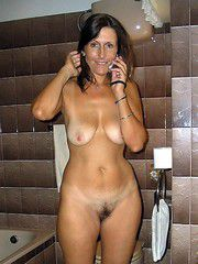 Beautiful naked milf calling her husband to work while she fucks at home