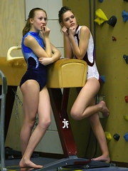 Sexy young friends Regina and Valentina work out in their school's gym, and they take a break and..