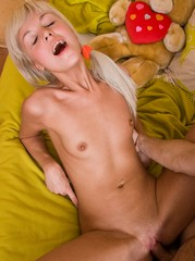 Cute teen on her knees swallowing cock..