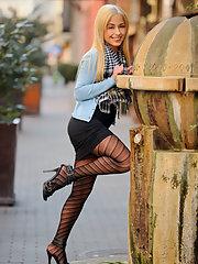 Beautiful blonde Nomi Melone teasingly..