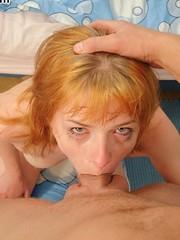 Throat fucked redhead slobbers on cock