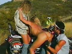 Blonde beach bitch gets fucked by two bikers