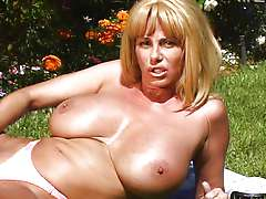 Busty MILF Penny Porsche masturbating outdoors