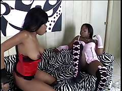Sexy black girls in lingerie lick and toy each other's pussies