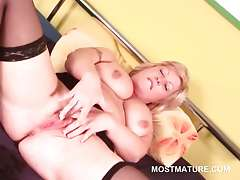 Fat blonde mature pleasuring her pink tasty pussy with lust