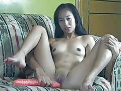 Filipina babe gets off with a huge dildo