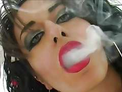 Cigarette smoking punk babe sucks cock