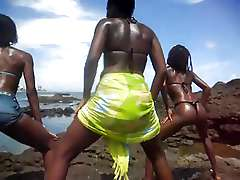 African teenagie in the sea side,..