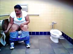Hidden camera in toilet, big sista pissing
