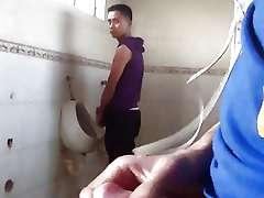 Mutual masturbation in public restroom