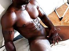 Muscled ebony dude jerks his big dick