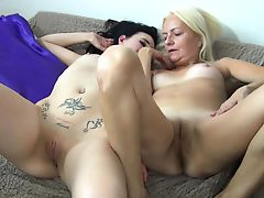 Young brunette girl masturbate with blonde granny in bed