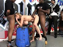 Katie Kox lined up by many black dudes that she suck