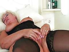 Chubby grandma in stockings rubs her clit