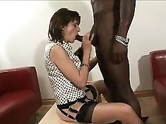 British dame sucks black dick