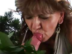 Grandma enjoying sex with a horny guy outdoors