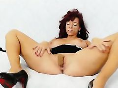 Pulling panty-hose out of pussy with the busty Vivien Fox
