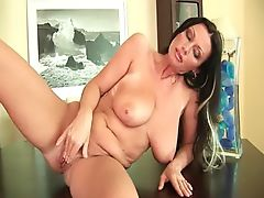 Soccer mom Pandora with her heavy boobs is dildoing her mature pussy