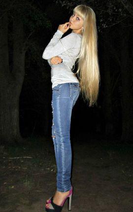 Long-legged angel in jeans