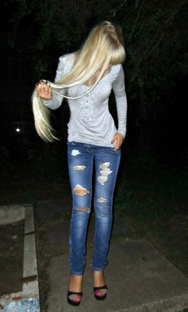 Teenager with a model figure in torn jeans