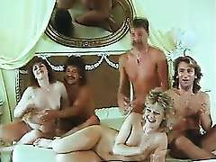 Cute women enjoys a big thick facial in the retro orgy